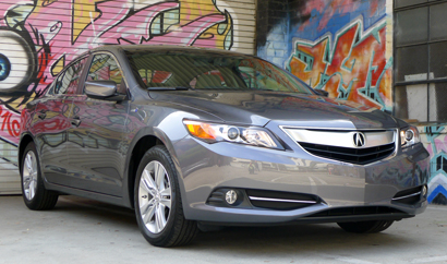 A three-quarter front view of a 2013 Acuara ILX Hybrid