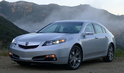 A three-quarter front view of a 2013 Acura TL SH-AWD