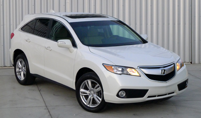 A three-quarter front view of a 2013 Acura RDX AWD Tech