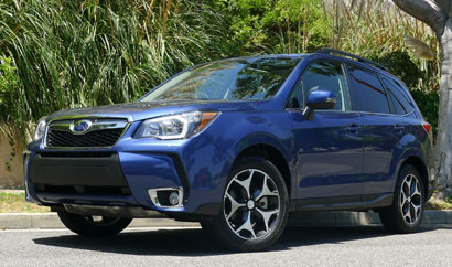 A three-quarter front view of a 2014 Subaru Forester 2.0XT