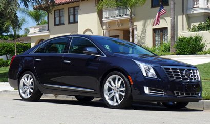 A three-quarter front view of the 2013 Cadillac XTS AWD Premium Collection