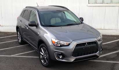 A three-quarter front view of the 2013 Mitsubishi Outlander Sport LE 2WD