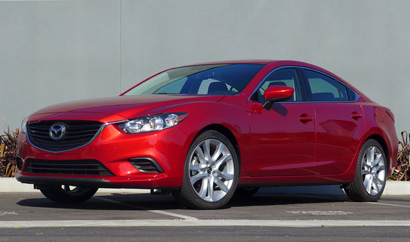A three-quarter front view of the 2014 Mazda 6 Touring