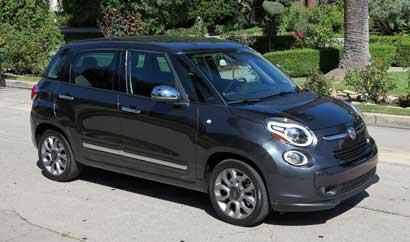 A three-quarter front view of the 2014 Fiat 500L