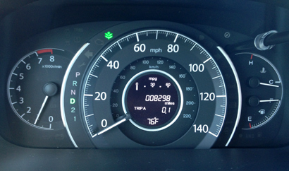The head-up display of the 2014 Honda CR-V EX-L AWD includes a leaf-shaped eco mode indicator