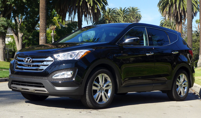 A three-quarter front view of the 2013 Hyundai Santa Fe Sport FWD 2.0T