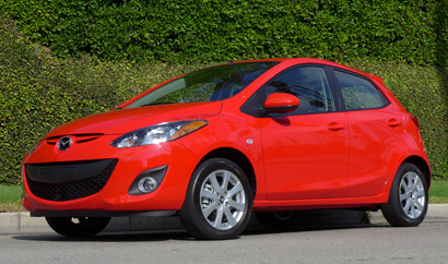 A three-quarter front view of the 2014 Mazda 2 Touring
