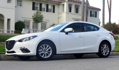 A side view of the 2014 Mazda 3 i 4-Door Touring