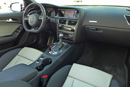The interior of the Audi S5 Cabriolet now features black wood and real aluminum inlays