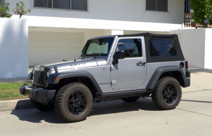 A three-quarter front view of the 2015 Jeep Wrangler Willys Wheeler