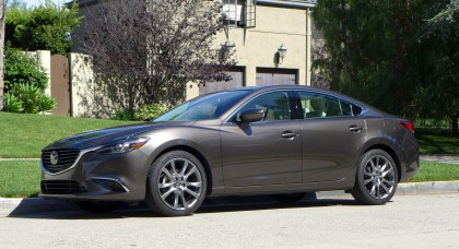 A three-quarter front view of the 2016 Mazda6 i Grand Touring