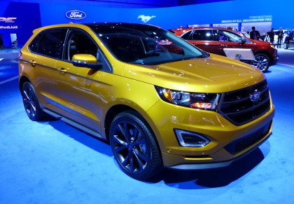 A three-quarter front view of the 2015 Ford Edge Sport AWD in electric spice
