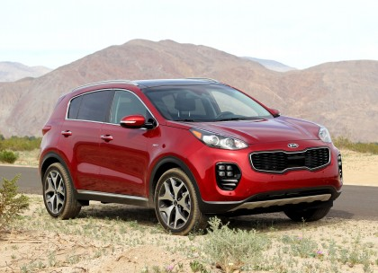 A three-quarter front view of a 2017 Kia Sportage SX AWD shown in Hyper Red